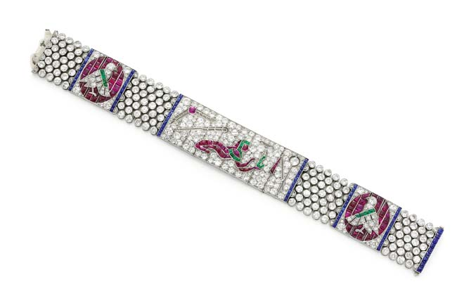 Egyptian revival bracelet by Lacloche Frères set with diamonds, rubies, emeralds and sapphires. Photo FD Gallery