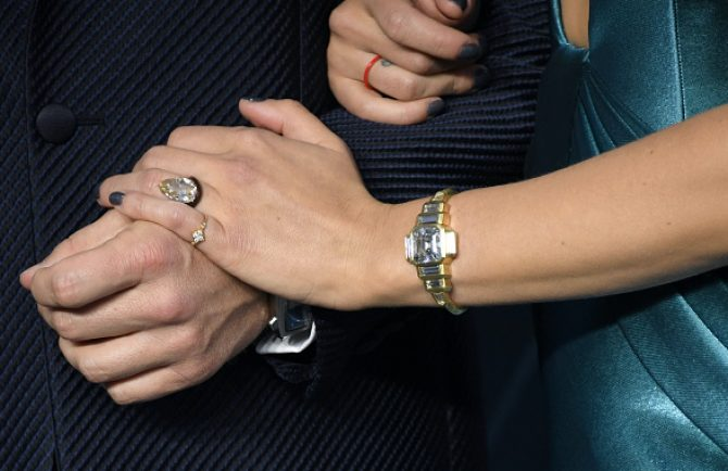Detail of the diamond bracelet, ceramic band and engagement ring all by Taffin designer James de Givenchy on Scarlett Johansson at the SAG Awards
