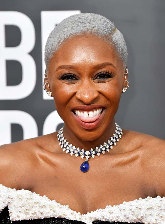 Cynthia Erivo wearing a a necklace and diamond studs by Bvlgari