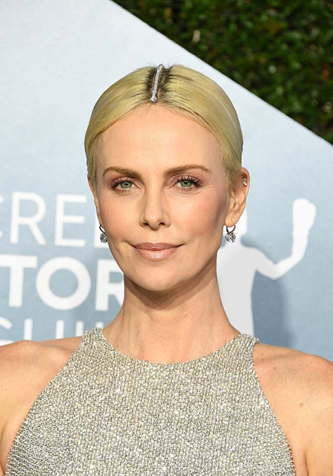 Charlize Theron wore a Hearts on Fire diamond bracelet in the part of her hair and diamond pendant earrings from the jeweler