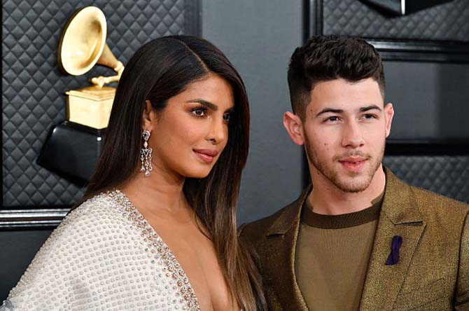 Nick Jonas with Priyanka Chopra wearing earrings by Chopard