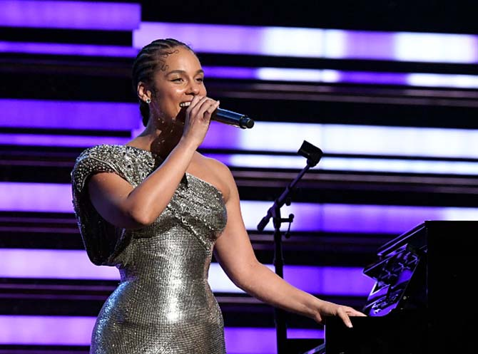 Host Alicia Keys wearing diamond studs.