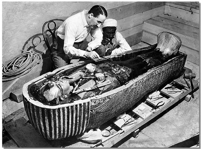 Howard Carter examining his discovery of King Tut in Egypt in 1922. Photo Wikipedia Commons