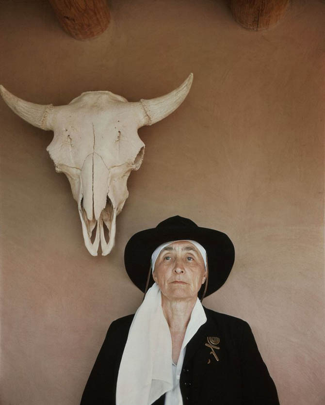 Georgia O'Keeffe wearing her brass Calder brooch in a 1948 portrait by Philippe Halsman at her home in Abiquiú, New Mexico. Photo via