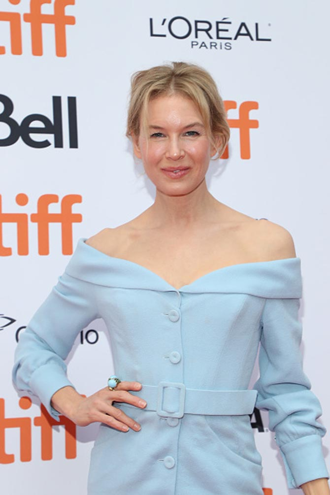 Zellweger wore a David Webb Crossover Ring with light blue and green enamel and 18K gold tothe 'Judy' Premiere at the 2019 Toronto International Film Festival on September 10,2019.