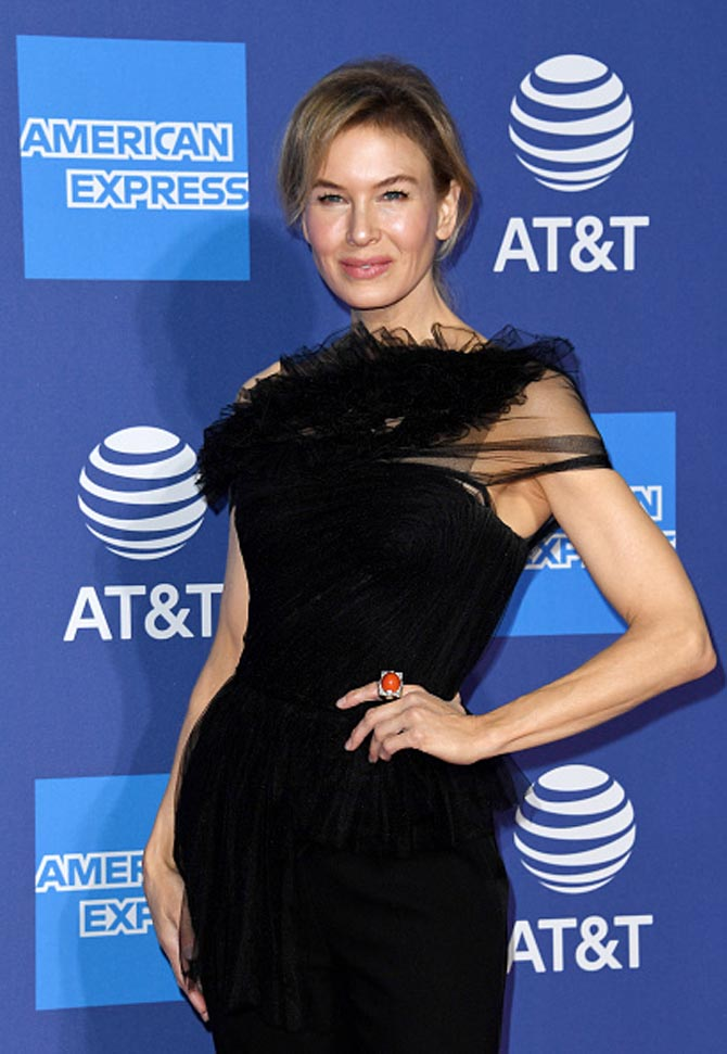 Zellweger wore David Webb's Grand Central Ring with cabochon coral, brilliant-cut diamonds, black enamel,18K gold, and platinum to the31st Annual Palm Spring International Film Festival Film Awards Gala on January 2, 2020.