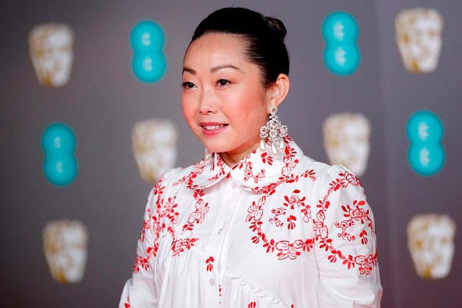 Director Lulu Wang wore stunning girandole earrings.