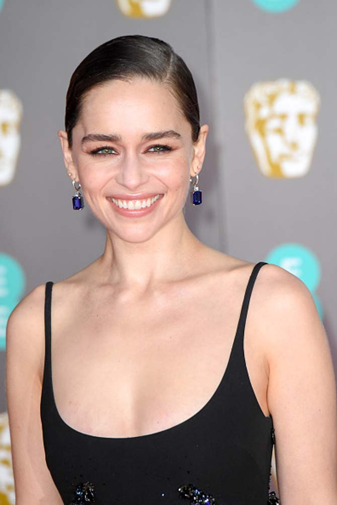 Emilia Clarke wore earrings by Asprey.