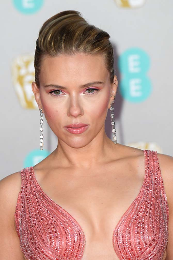 Scarlett Johansson wore diamond earrings by Nikos Koulis at the BAFTAs