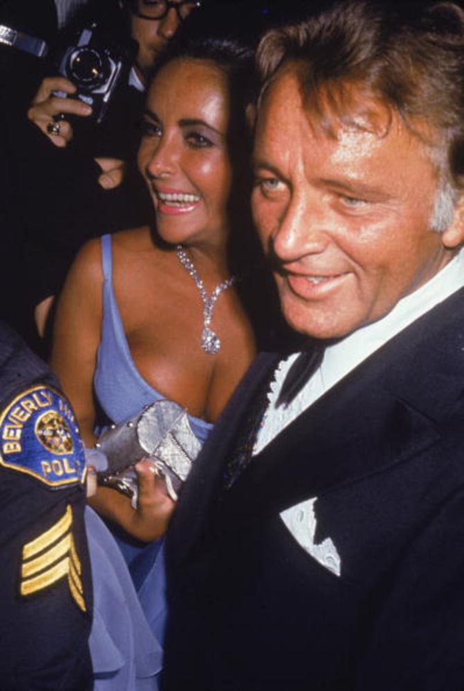 Married actors Elizabeth Taylor and Richard Burton (1925 - 1984) smile as they attend the Academy Awards ceremonies, Los Angeles, California, April 7, 1970.