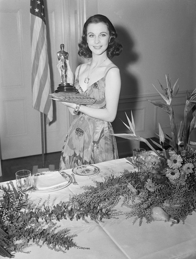 Vivien Leigh proudly holds her Best Actress Oscar on March 2, 1940. She was recognized for her portrayal of Scarlett O'Hara in Gone With the Wind.