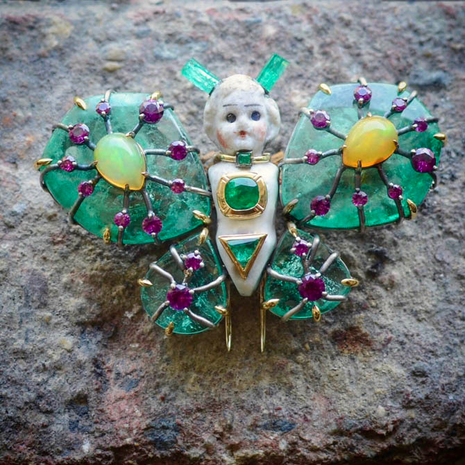 Castor's Motha brooch composed of antique porcelain, emeralds, purple garnets and opals. Photo courtesy