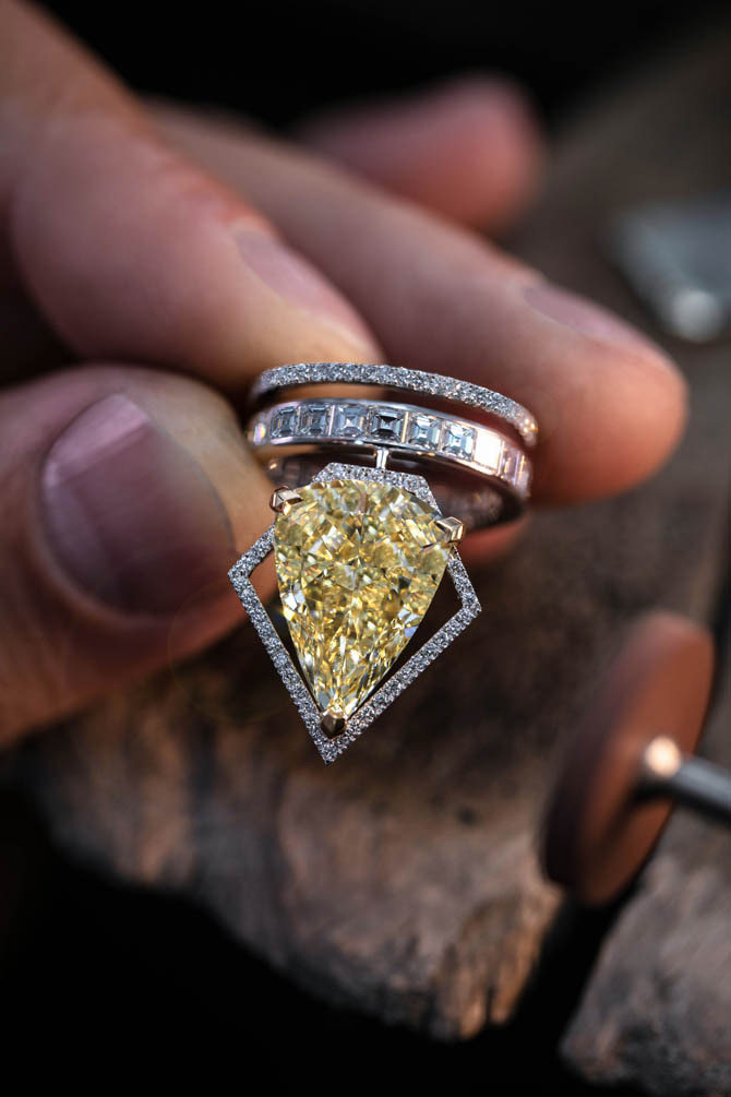 A diamond ring from Messika's Voltage collection set with a 10.19-carat fancy yellow pear shape diamond.