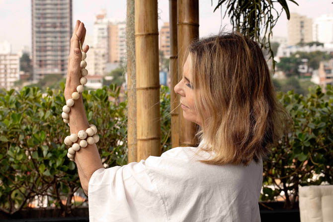 Jewelry designer Silvia Furmanovich analyzing a jarina necklace. Photo courtesy